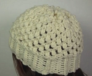 Learn to loom knit the popcorn stitch.